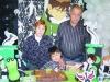 O aniversariante Eduardo com os avós Eda e Dilamar