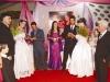 Jorge Luis, Ermínia recebendo o anel do tio João Carlos, Mara, tio Rudnei entregando o anel a Isabel e o avô Loeci